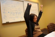 """Me celebrating during an Ashland U residency when a student connected all the dots. Behind me is one of the """"whiteboardings"""" my students are sometimes subjected to."""