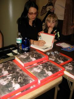 Me and my son at my first signing for Opa Nobody in Georgia in 2008. How cute is he?